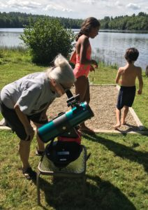 Reed Dyer's family members enjoy the telescope on their summer vacation in Maine.