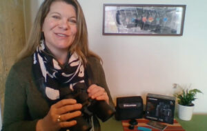 Sarah holding binoculars